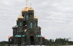 """MOSCOW REGION, RUSSIA - JUNE 14, 2020: A view of the Cathedral of the Resurrection of Christ, Main Cathedral of the Russian Armed Forces, consecrated in the town of Kubinka. The cathedral and the adjacent museum were built in Patriot Park to mark the 75th anniversary of the victory in World War II. Initially, the consecration ceremony was to take place on May 9, but had to be rescheduled due to the ongoing COVID-19 pandemic. Mikhail Metzel/TASS  Ðîññèÿ. Ìîñêîâñêàÿ îáëàñòü. Âèä íà ñîáîð Âîñêðåñåíèÿ Õðèñòîâà - ãëàâíûé õðàì Âîîðóæåííûõ ñèë ÐÔ. Õðàì è âîåííûé ìóçåé âîçâåëè â ïàðêå êóëüòóðû è îòäûõà """"Ïàòðèîò"""" ê 75-ëåòèþ Ïîáåäû â Âåëèêîé Îòå÷åñòâåííîé âîéíå. Öåðåìîíèÿ îòêðûòèÿ è îñâÿùåíèÿ ïàòðèàðøåãî ñîáîðà äîëæíà áûëà ñîñòîÿòüñÿ 9 ìàÿ, â Äåíü Ïîáåäû, îäíàêî áûëà îòëîæåíà èç-çà ïàíäåìèè êîðîíàâèðóñà. Ìèõàèë Ìåòöåëü/ÒÀÑÑ"""